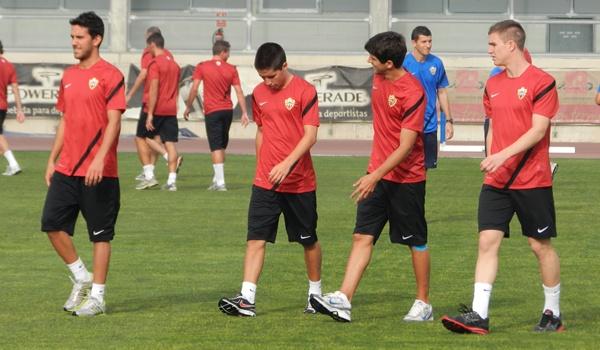 Joselu, Cristobal y Raúl García, del Almería B, junto a Abel Molinero, ahora en al primera plantilla