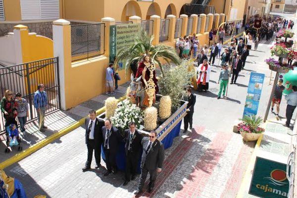 'La Borriquita' procesiona por las calles de Gádor llegado el Domingo de Ramos