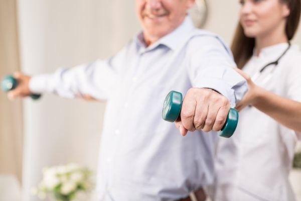Retiree training with dumbbells
